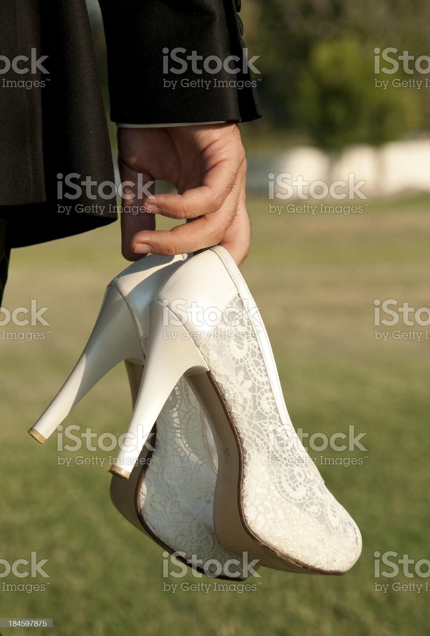 groom with wedding shoes royalty-free stock photo