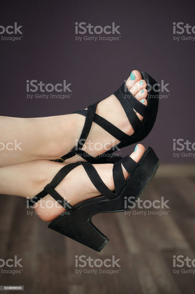 groomed female feet in sandals stock photo