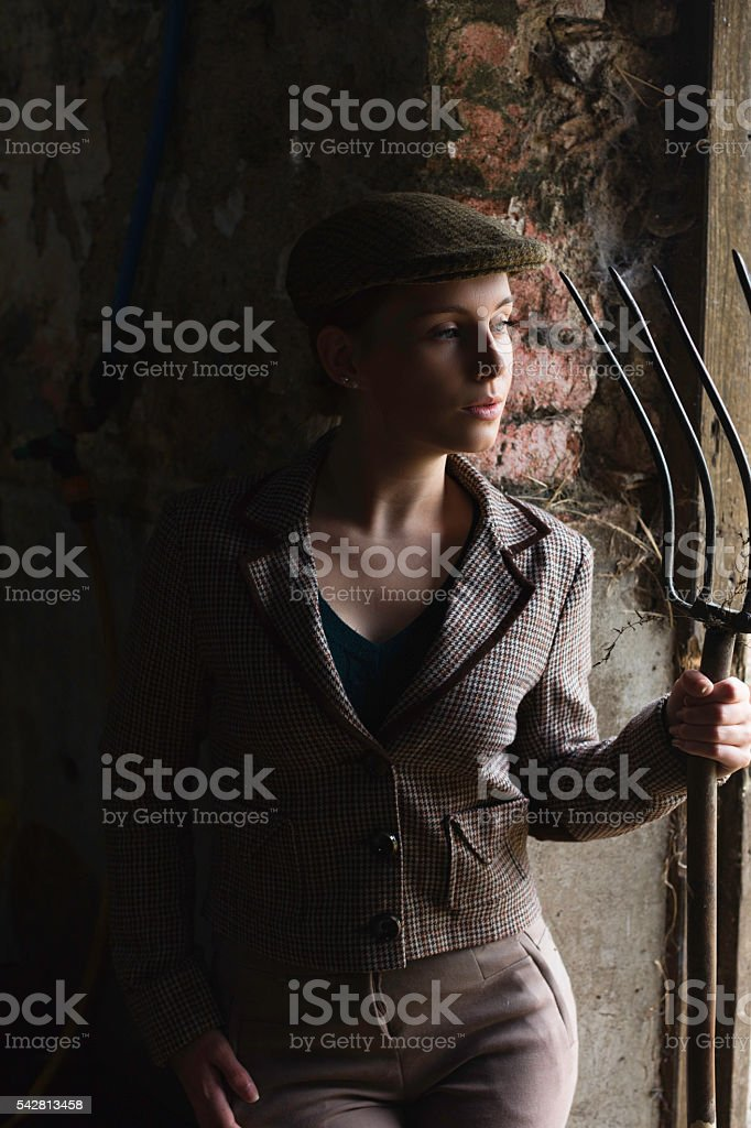 Groomer With Her Hayfork stock photo