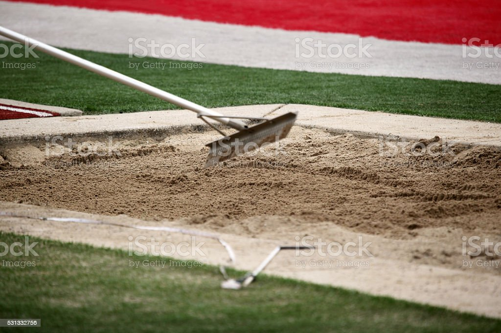 Grooming long jump sand pit.  Copy space. stock photo