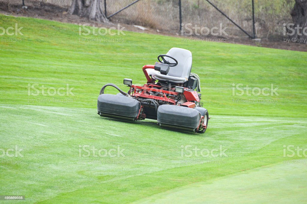 Grooming the golf course stock photo