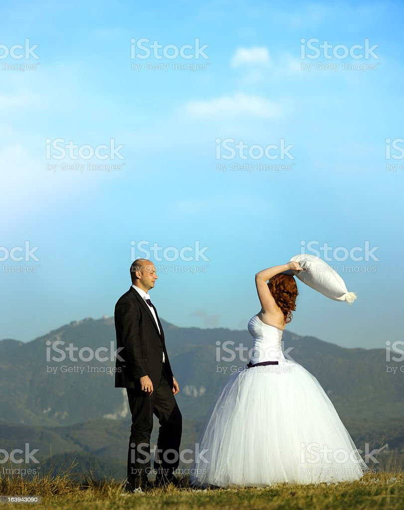 grooms having fun with pillow royalty-free stock photo