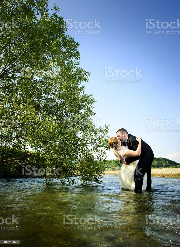 grooms in water royalty-free stock photo