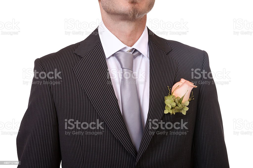 Groom's necktie and boutonniere stock photo