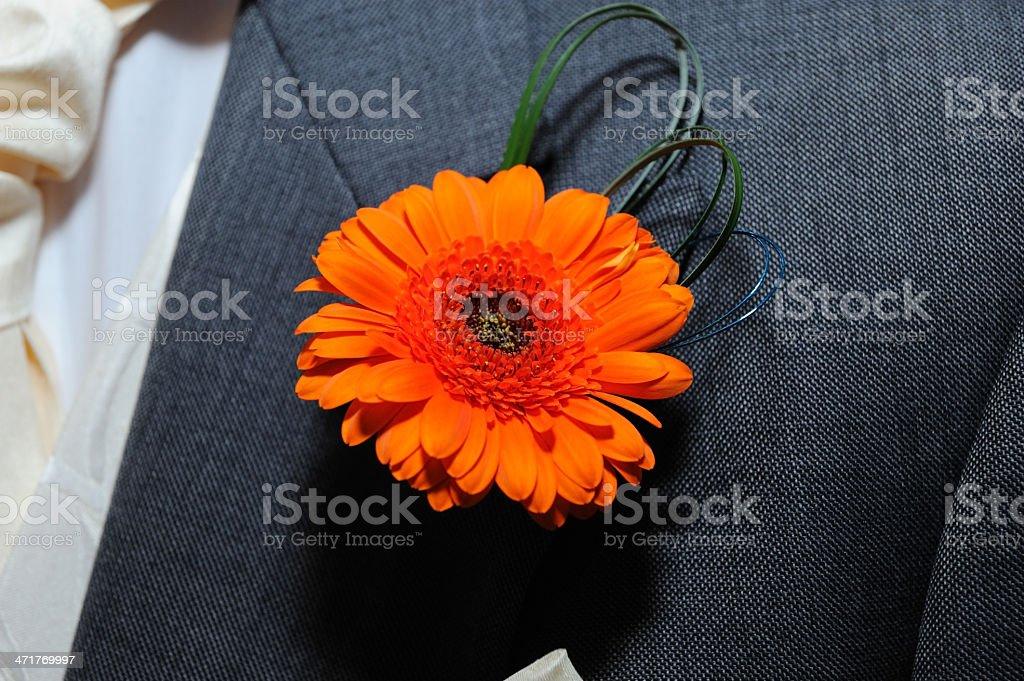 Grooms orange buttonhole. stock photo