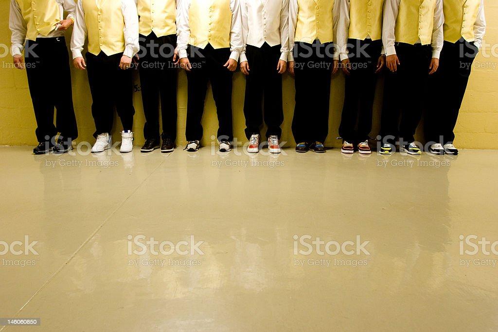 groomsmen against wall royalty-free stock photo
