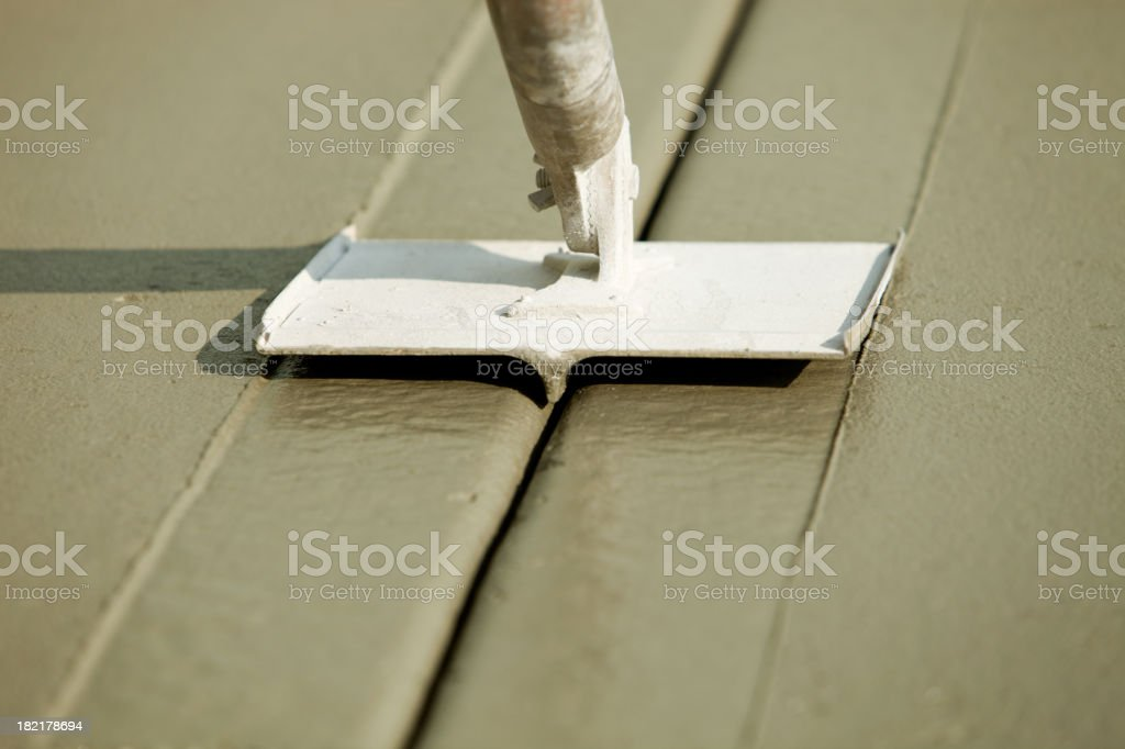 Groover Slicing Wet Freshly Poured Concrete royalty-free stock photo