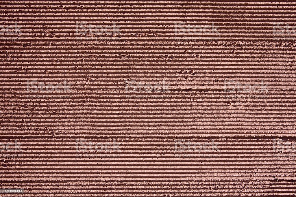 Grooving lines in masonry or stucco; background royalty-free stock photo