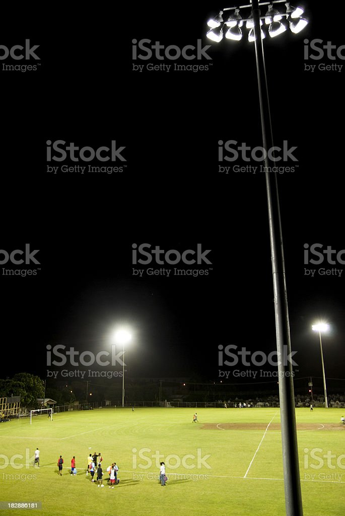 Gros Islet playing field and athletes under floodlights royalty-free stock photo