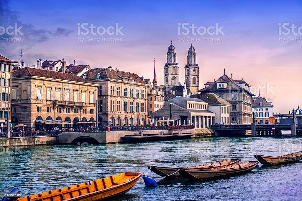 Grossmunster Cathedral with River Limmat in Zurich at Sunset stock photo