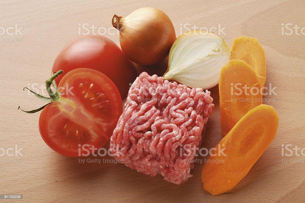 Ground beef carrot tomato onion royalty-free stock photo