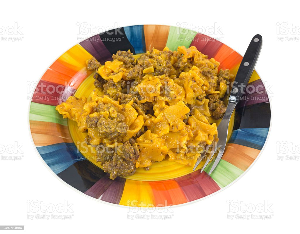 Ground beef with cheesy pasta on plate stock photo