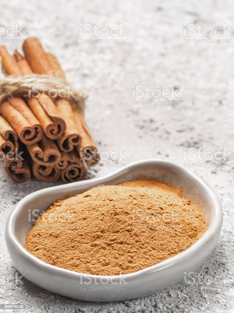 Ground cinnamon on gray background stock photo