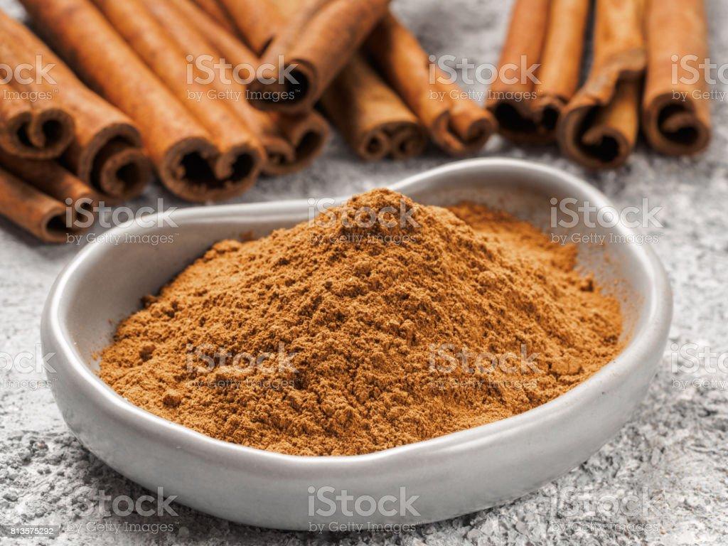 Ground cinnamon on gray background stock photo