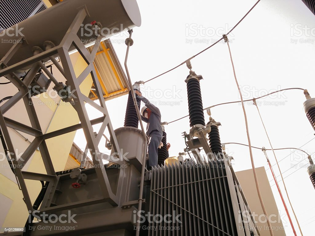 ground clamps to connection on reducing power transformer stock photo