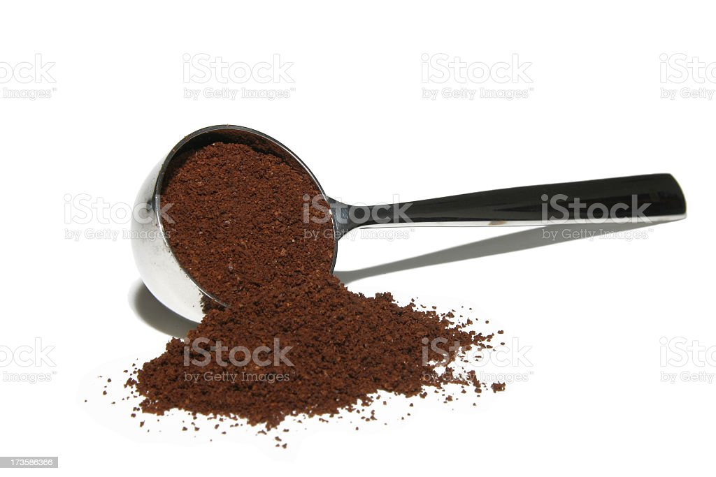 Ground coffee in a metal coffee scoop stock photo