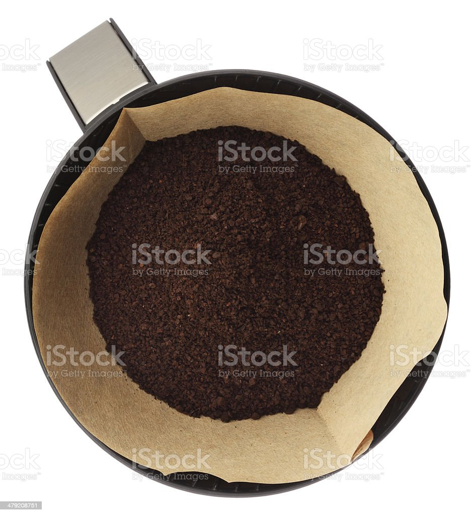Ground coffee in filter isolated on white background overhead view stock photo