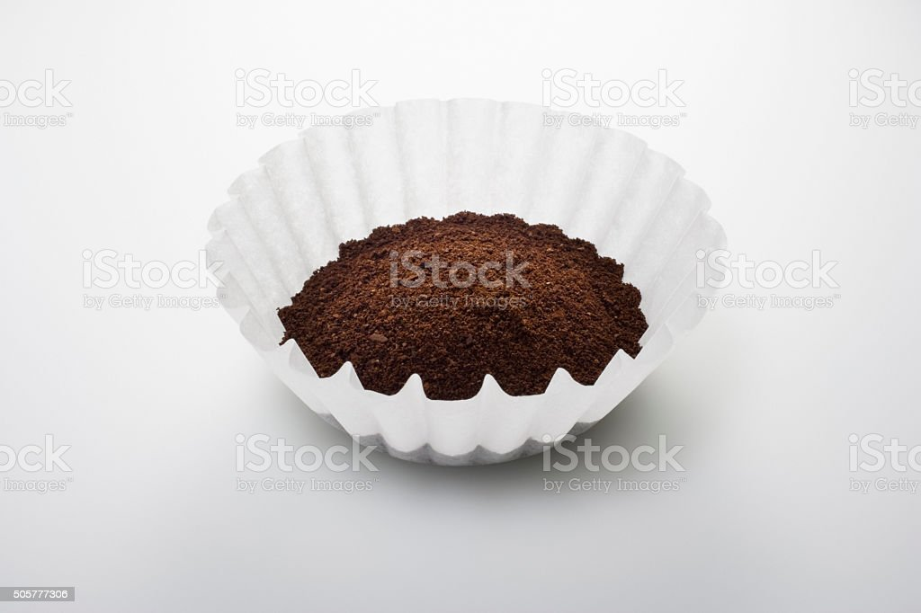 Ground coffee in filter stock photo