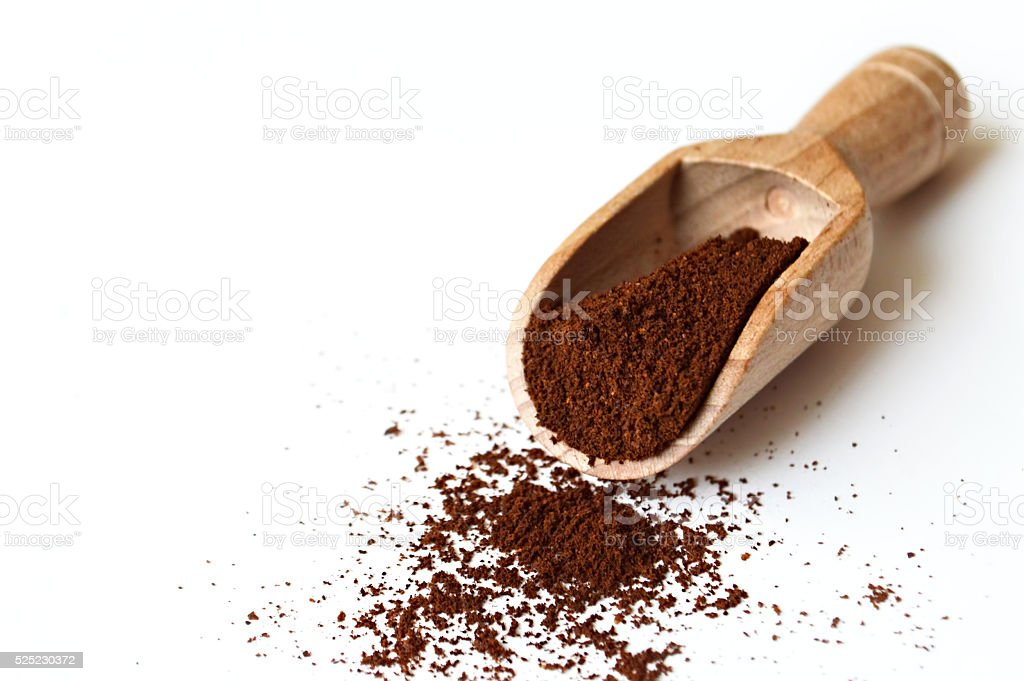 Ground coffee in wooden scoop stock photo