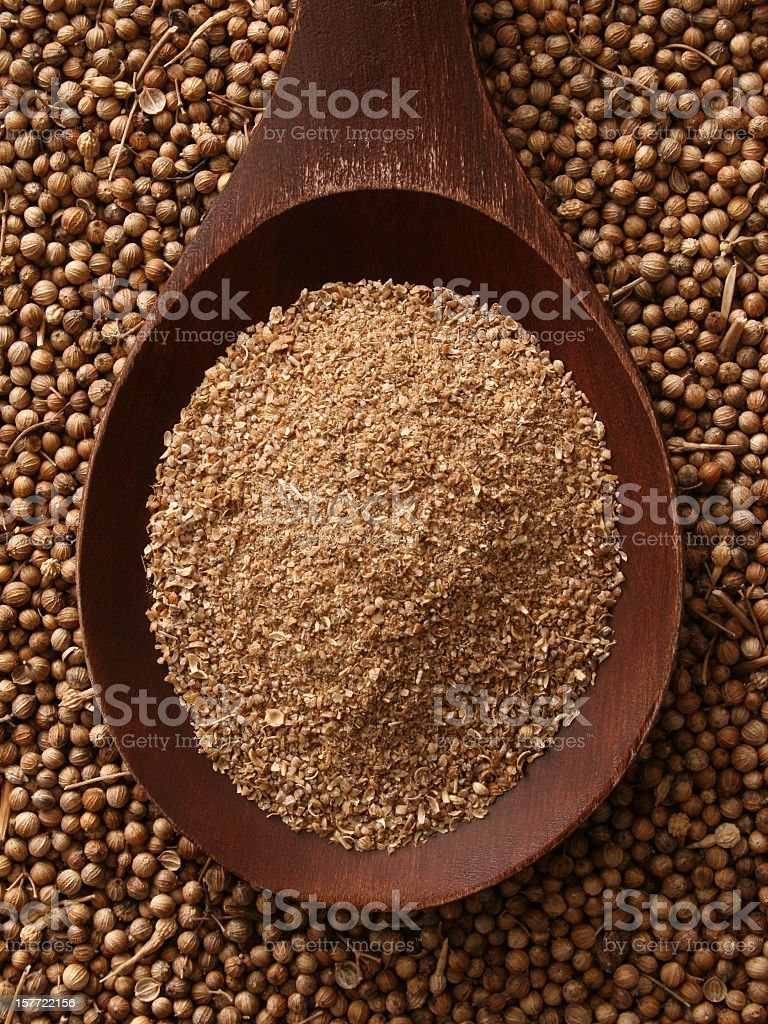 Ground coriander seeds stock photo