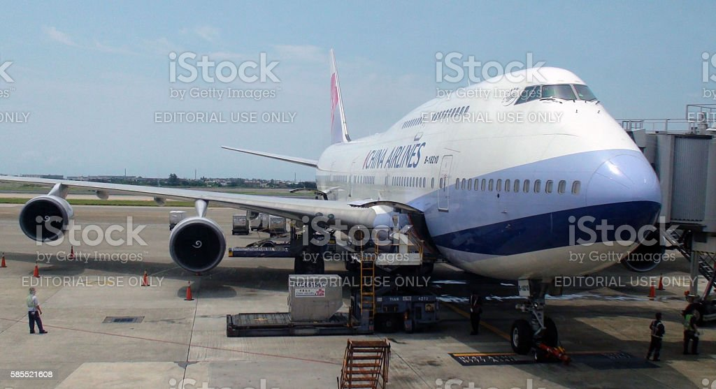 Ground Crew Loading Goods Into China Airlines Airplane stock photo
