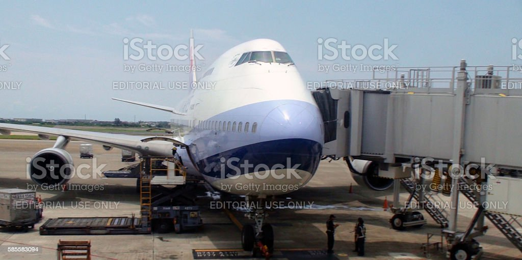 Ground Crew Loading Goods Into China Airlines Airplane.Taipei stock photo