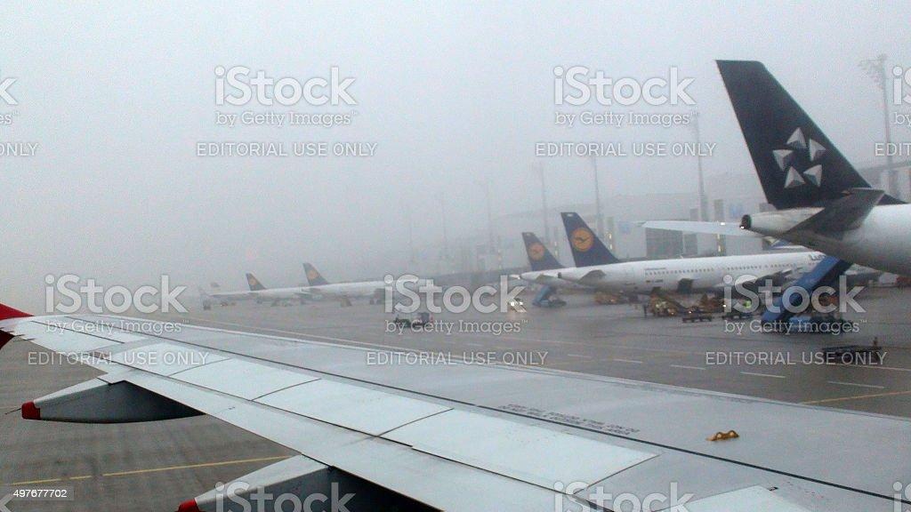 Ground Crew Loading Lufthansa Airplane At Loading Gate Of Munich.Airport stock photo