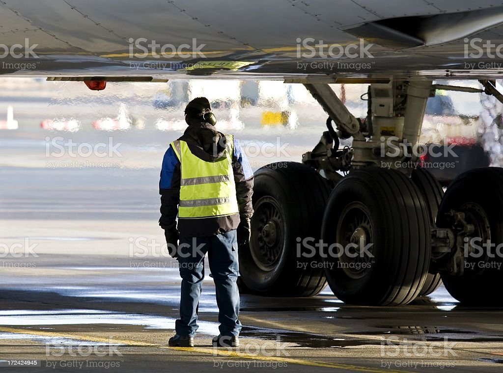 Ground crew preparing big jet for take off stock photo