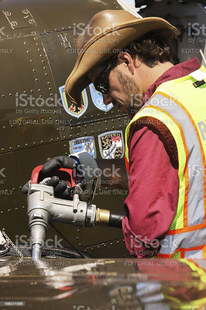 Ground Crew Refueling Military Airplane Gas Tank stock photo