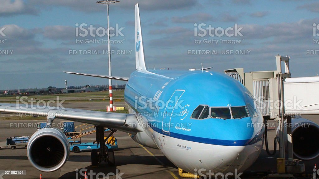 Ground Crew Unloading KLM Aircraft At Schiphol Airport Amsterdam stock photo