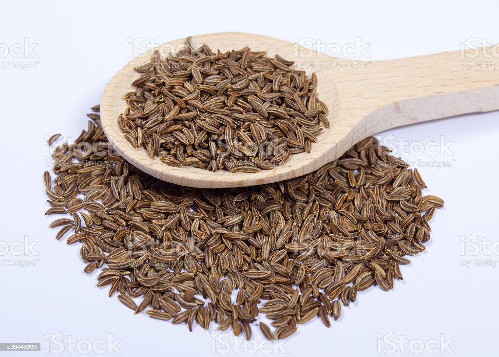 Ground cumin in a spoon. stock photo