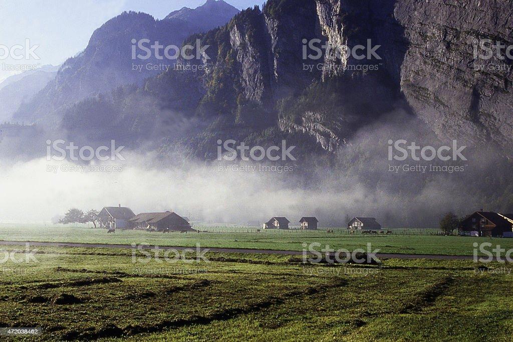 Ground Fog valley bottom and farms Lauterbrunnen Interlaken region Switzerland stock photo