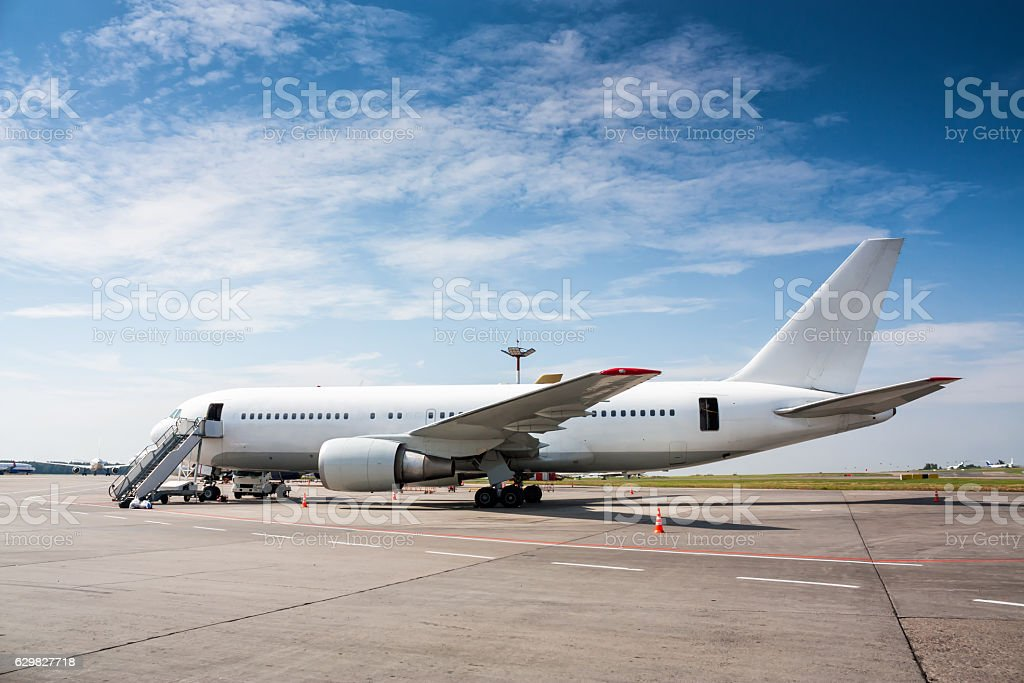 Ground handling wide-body passenger aircraft royalty-free stock photo