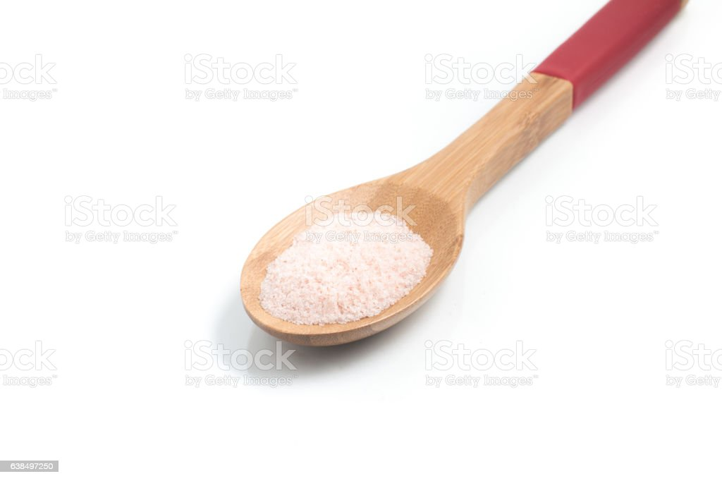 Ground Himalayan pink Salt into a spoon stock photo