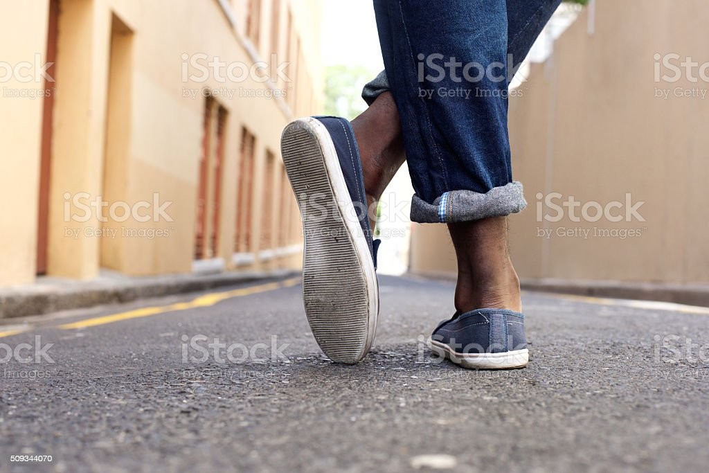 Ground level man standing on street stock photo