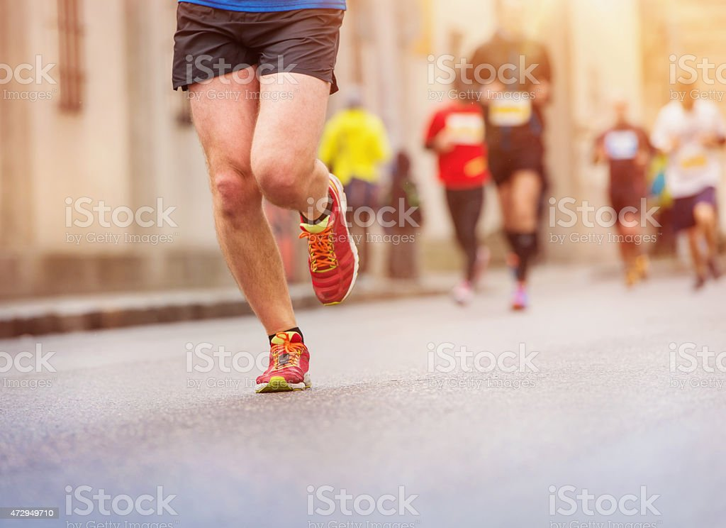 Ground level photo of people running a marathon  stock photo