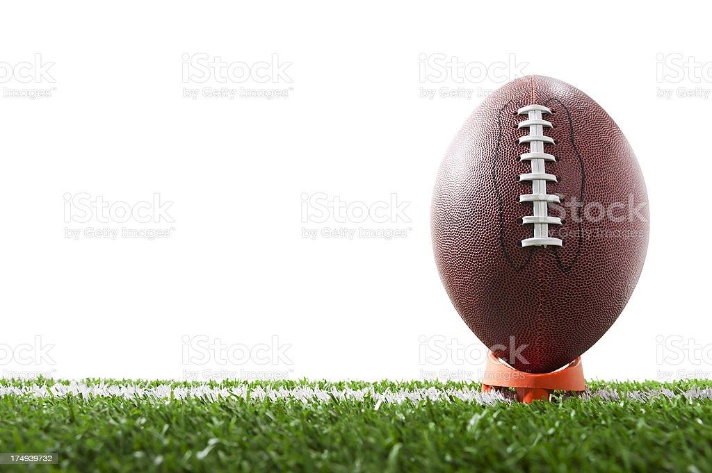 Ground level shot of football on tee stock photo