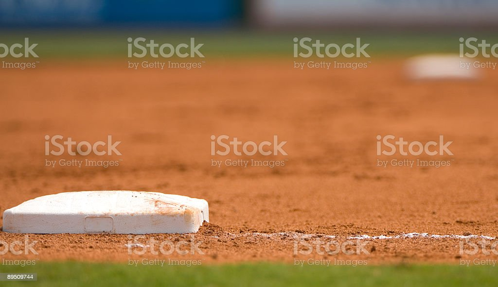 Ground level view of a base on the baseball field stock photo