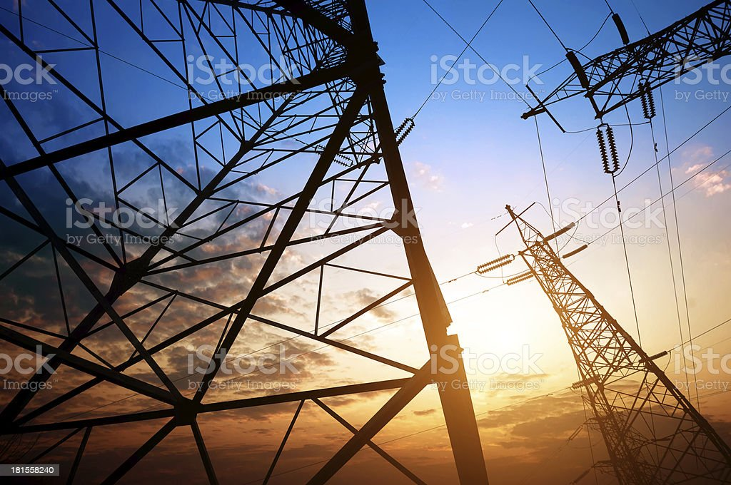 Ground level view of high-voltage pylons stock photo