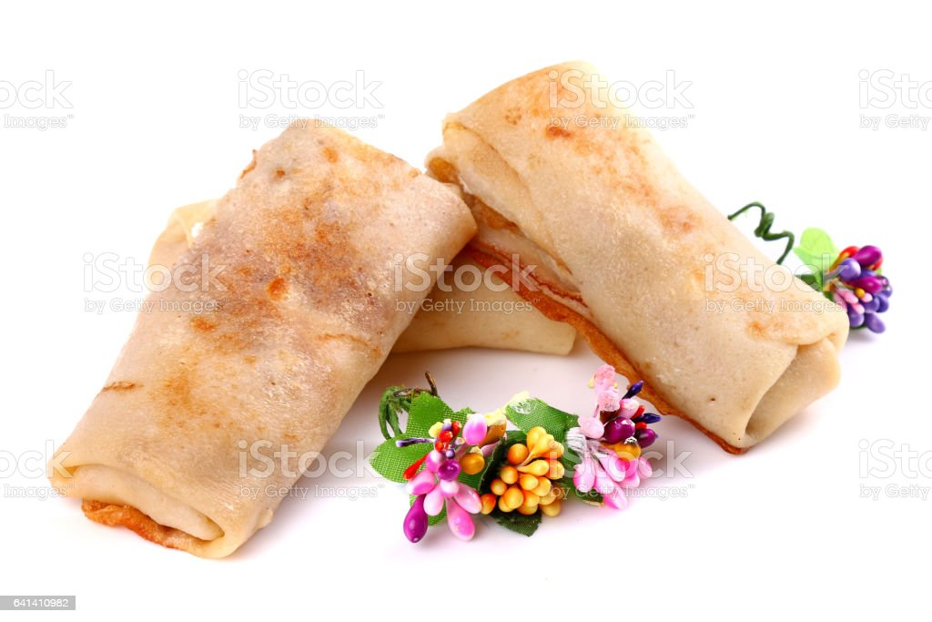 Ground meat filled pancakes stock photo