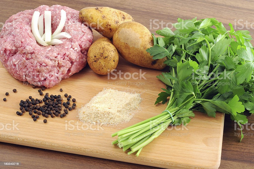 Ground meat in form of Hedgehog breadcrumbs onions pepper parsley stock photo