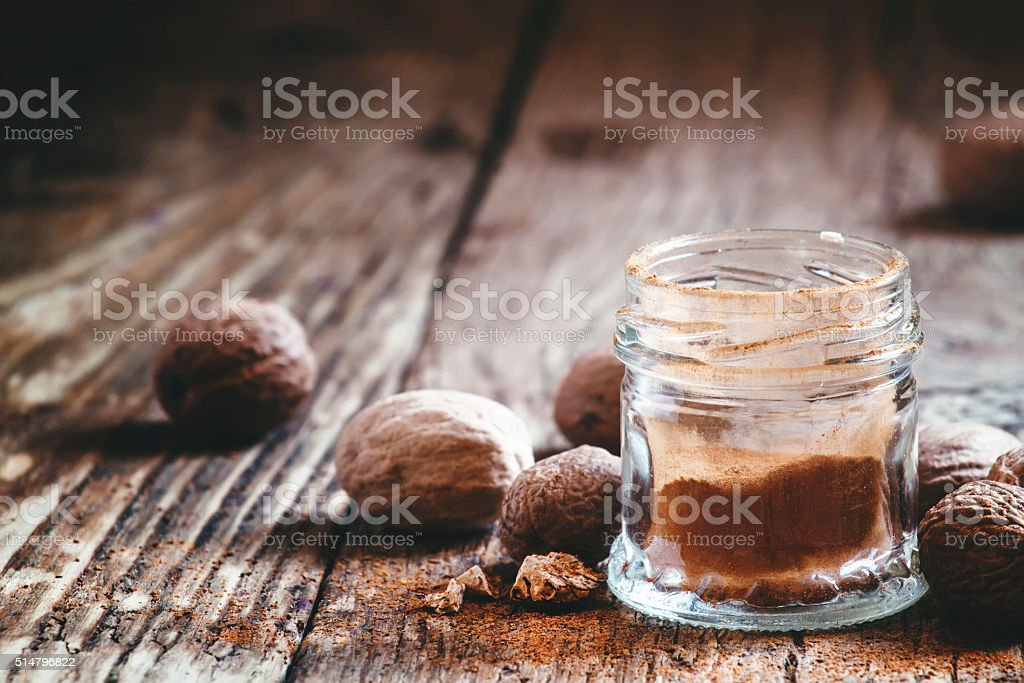 Ground or whole nutmeg stock photo