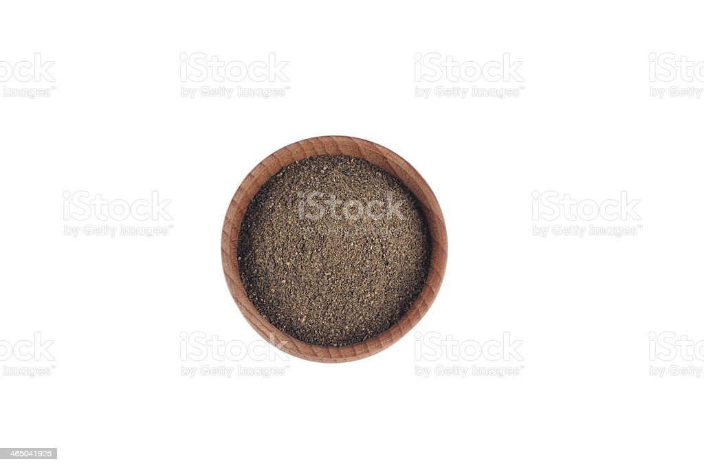 Ground pepper in the wooden bowl stock photo