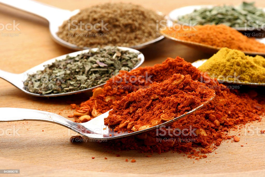 Ground red pepper and other spices stock photo