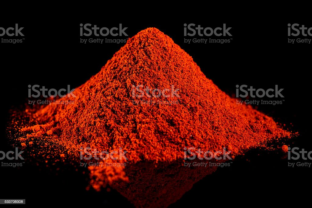 Ground red pepper on a black background stock photo