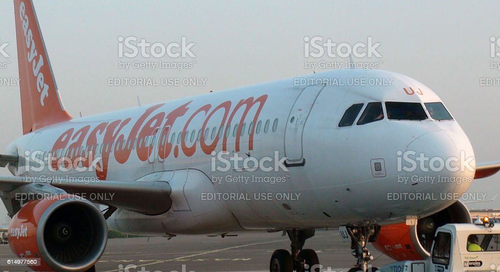 Ground Stewardess With Pushback Tractor Towing Easyjet To Runaway.Amsterdam,Netherlands.Europe stock photo