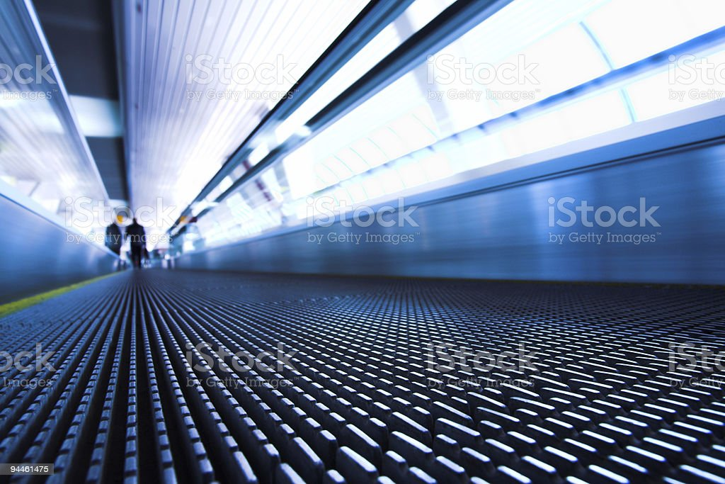 Ground view of a moving escalator in a modern office stock photo