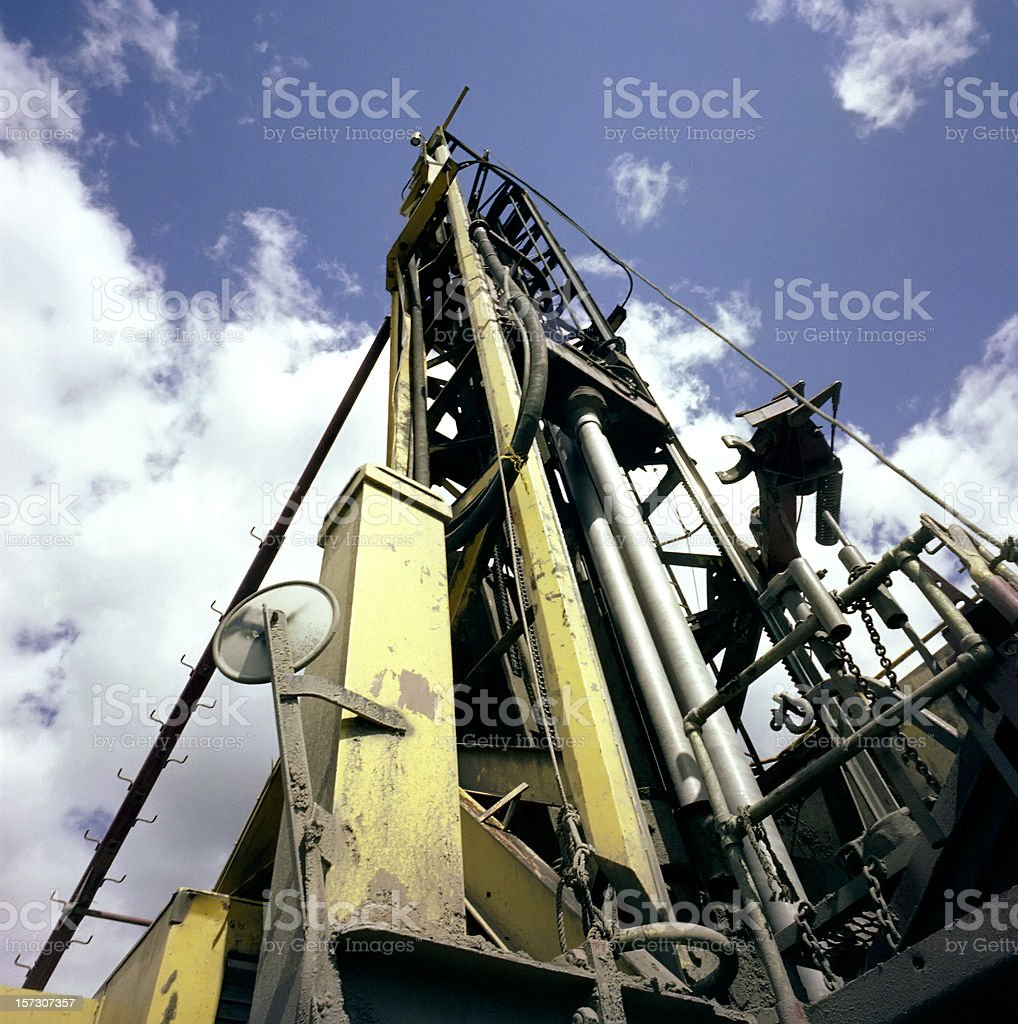 Ground view of a rock drill and the sky royalty-free stock photo