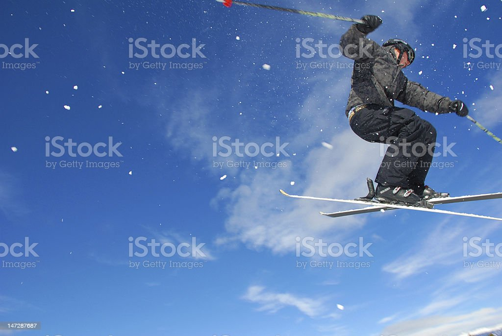 A ground view of a skier with snow royalty-free stock photo