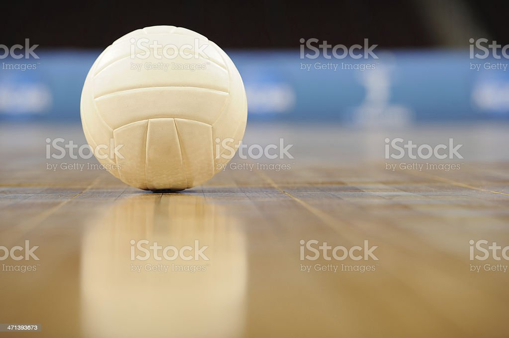 Ground view of a volleyball on the floor in an empty gym stock photo